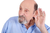 Portrait of deaf old man trying to listen