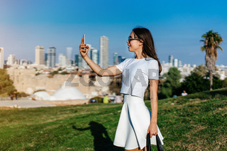 Young attractive woman taking selfie
