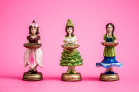 Collection of Statuettes of Girls Holding Tray