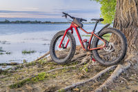 fat mountain bike on a lake shore