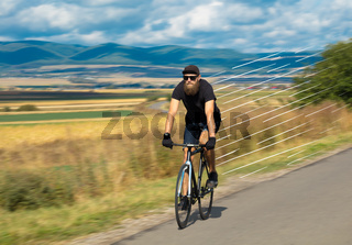 Casual cyclist riding bicycle very fast