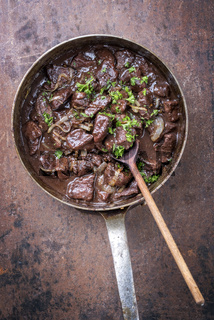 Fresh veal liver ragout in red wine sauce as top view in a casserole