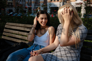 Lesbian couple together outdoors