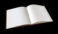 Open blank notebook isolated on black