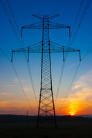 Transmission towers at sunrise