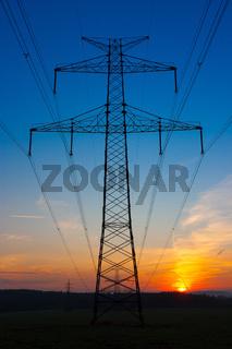 Transmission towers at sunrise
