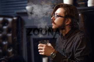 Smoking man drinking whiskey