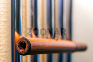 Metal tubular bells with a bamboo tube hang on the wall and create the music of the wind.