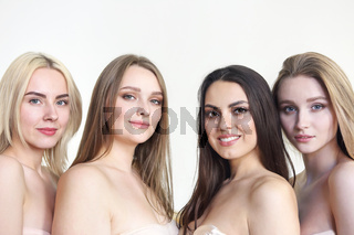 Beautiful multicultural young woman posing Camera isolated over white. Body Positivity