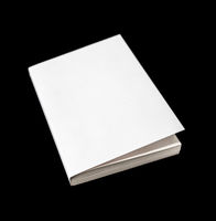 Closed blank book isolated on black