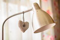 Cloth heart decoration hanging on lamp pillar