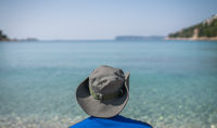 Tourist with a hat on a sea shore