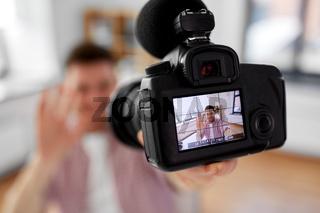 close up of camera recording male video blogger