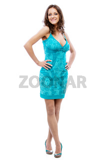 Portrait of young smiling beautiful woman with dark hair in blue dress in full growth