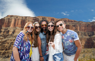 friends taking selfie by monopod at grand canyon