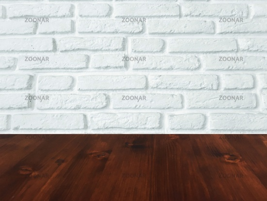 brown wood table with white brick wall texture background.