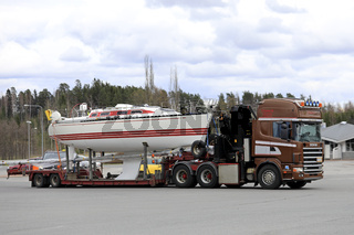Boat Transport by Brown Scania Semi Trailer