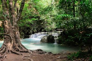 Erawan falls waterfall in tropical forest at Erawan National Park, in Kanchanaburi province, Thailand.