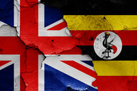 flags of UK and Uganda painted on cracked wall