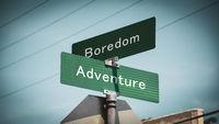 Street Sign to Adventure versus Boredom