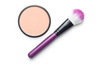 Face powder and makeup brush.