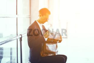 Businessman sitting at metro station.