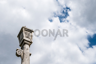 Wooden lantern sculpture and cloudy sky
