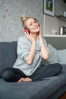 Portrait of attractive woman using smart phone to listen to music