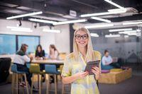 blonde businesswoman working online using digital tablet