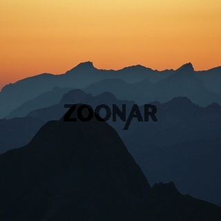 Sunset view from Mount Brienzer Rothorn, Switzerland. Outlines of Mount Tannhorn and other mountains.