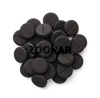 Top view of activated charcoal tablets