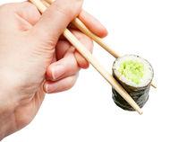 chopsticks hold kappa roll with cucumber close up
