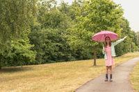 Happy child in the rain