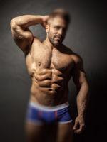 bearded muscular man with creative defocus