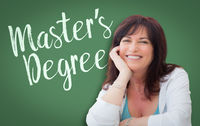 Master's Degree Written On Green Chalkboard Behind Smiling Middle Aged Woman