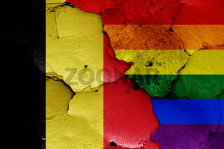 flags of Belgium and LGBT painted on cracked wall
