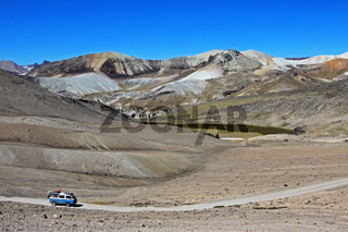 Old german vintage campervan cruising road in the andean mountains, Peru, South America