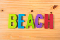 Beach in colorful wooden letters