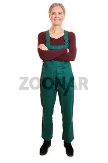 Frau als Gärtner in Arbeitskleidung