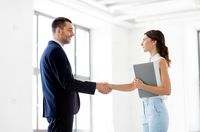 businesswoman and businessman shake hands