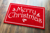 Merry Christmas Red Welcome Mat On Wood Floor Background