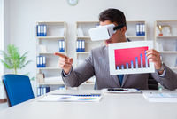 Businessman with virtual reality glasses in the office