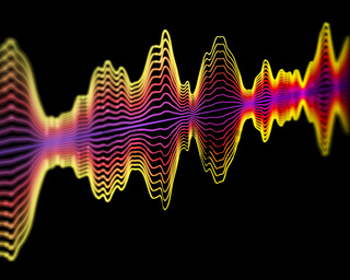 Speech recognition technology or sound recording concept: multicolor sound waves.