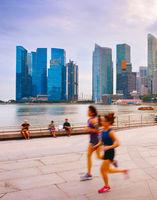 People running at promenade Singapore
