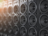 Audio  sound speaker system. Black loudspeakers in a row with DOF effect. Music club background.