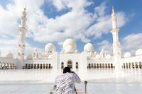 Male tourist taking photo Sheikh Zayed Grand Mosque in Abu Dhabi, the capital city of United Arab Emirates