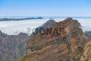 Mountain landscape with low-slung clouds at Madeira seen from Pico do Arieira