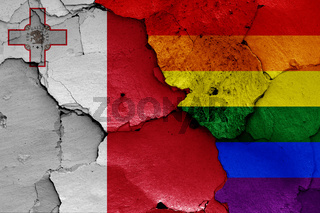 flags of Malta and LGBT painted on cracked wall
