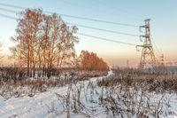Winter suburban landscape with power line