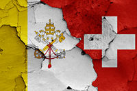 flags of Vatican and Switzerland